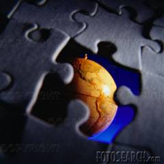 globe seen through a missing puzzle piece. fotosearch - search stock photos, pictures, images, and photo clipart
